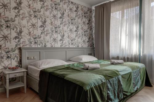 Postel nebo postele na pokoji v ubytování Louren Apartments Charles Bridge