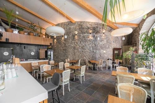 A restaurant or other place to eat at Rija Old Town Hotel