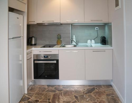 A kitchen or kitchenette at Heraklion Old Port Apartments