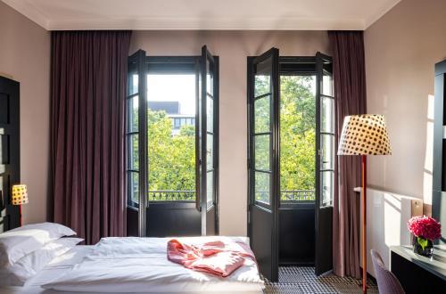Cama o camas de una habitación en The Midtown Hotel