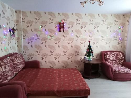 Кровать или кровати в номере Апартаменты на Ленина 5 А