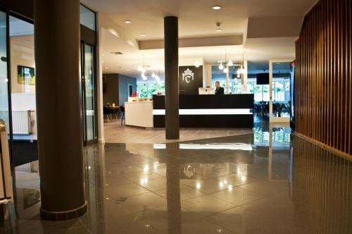 The lobby or reception area at Hotel Corsendonk Viane