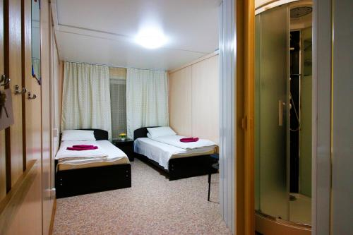 A bed or beds in a room at Star of Baikal