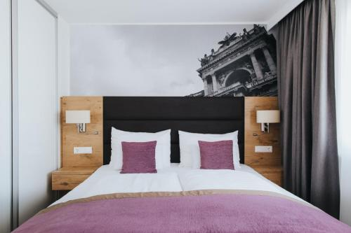 A bed or beds in a room at Parks 73 The Townhouse Hotel