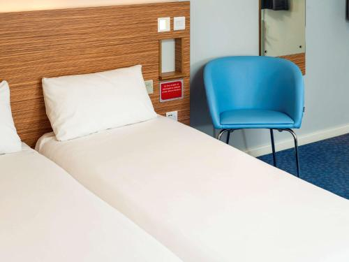 A bed or beds in a room at ibis budget London Bromley Town Centre