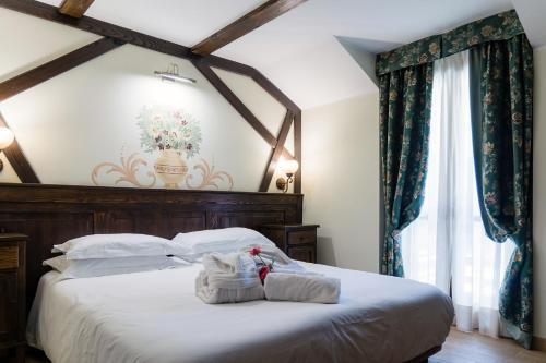 Letto o letti in una camera di Chalet du Lys Hotel & SPA