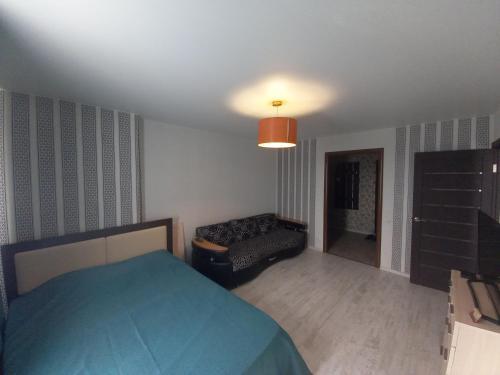 Krevet ili kreveti u jedinici u okviru objekta Apartments 30 micro-district, 9