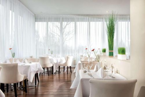 A restaurant or other place to eat at Wyndham Garden Wismar