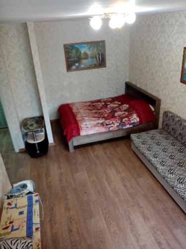 Кровать или кровати в номере Apartment Anapskoe Shosse 1