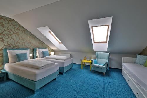 A bed or beds in a room at Hotel Pod Bránou