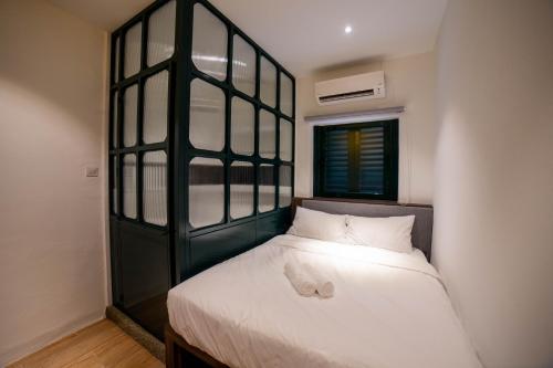 Cama o camas de una habitación en Eastern Hotel Georgetown