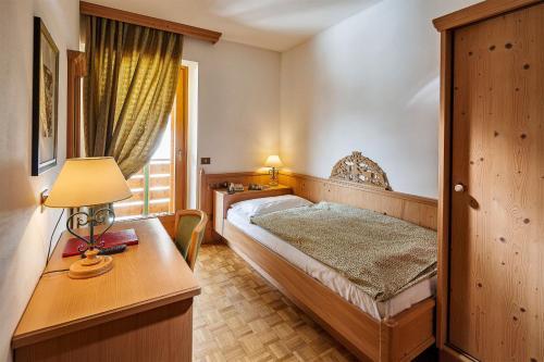Cama o camas de una habitación en Hotel Piccolo Pocol