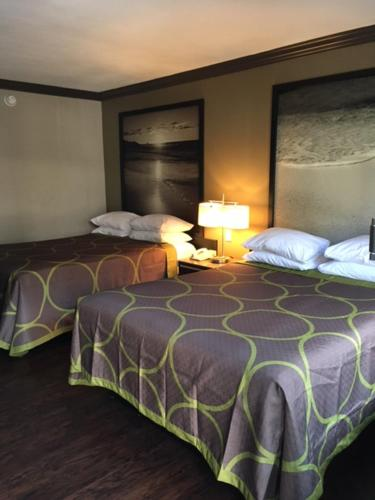A bed or beds in a room at Skyways Hotel