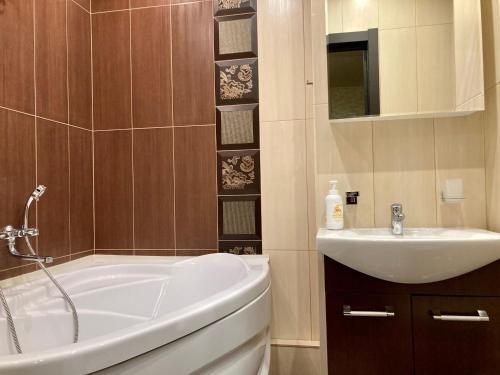 Ванная комната в Апартаменты на ул. Восход 21