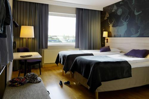 A bed or beds in a room at Scandic Helsingborg Nord
