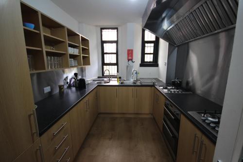 A kitchen or kitchenette at Tartan Lodge