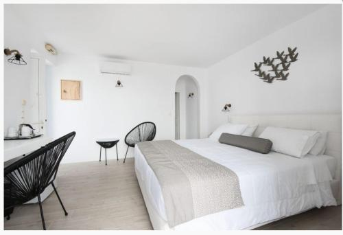 A bed or beds in a room at Hotel Tagoo