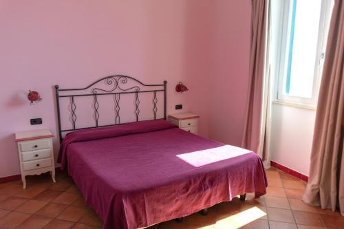 A bed or beds in a room at B&B Il Porticciolo di Amalfi