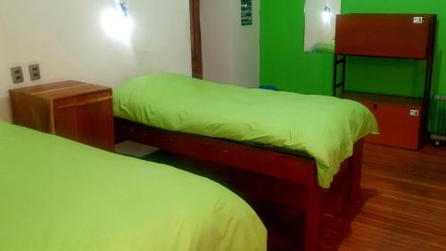 A bed or beds in a room at The Adventure Brew Hostel