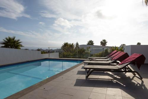 The swimming pool at or near Hoopoe Villas Lanzarote