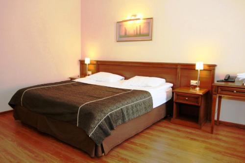 Кровать или кровати в номере Мотель A-108