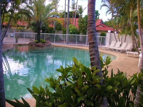 The swimming pool at or near Runaway Bay Motor Inn