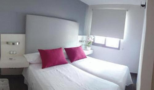 Een bed of bedden in een kamer bij Hotel Avenida 31