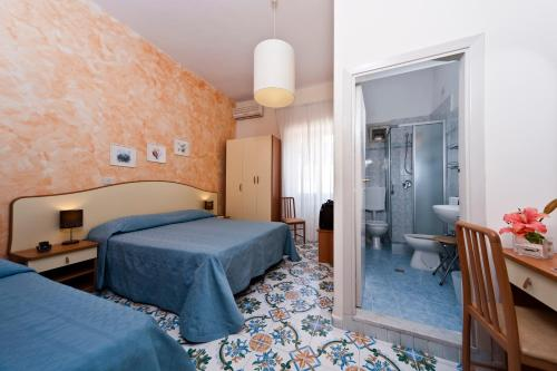 A bed or beds in a room at Hotel Casa Di Meglio