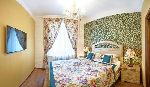 Кровать или кровати в номере Apartment on Rubinsteina 9/3