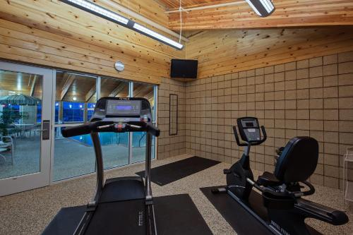 The fitness center and/or fitness facilities at AmericInn by Wyndham Newton