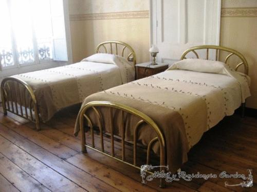 Cama o camas de una habitación en Hotel Garden