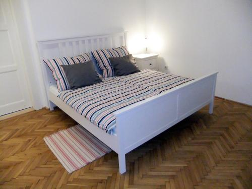 A bed or beds in a room at PANORAMA apartmán ajaj