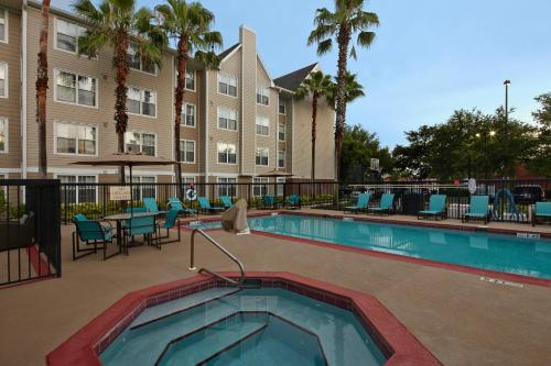 The swimming pool at or near Residence Inn by Marriott Orlando East/UCF Area