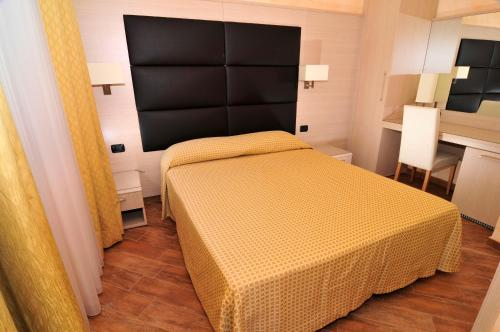 A bed or beds in a room at La Locanda del Cavaliere