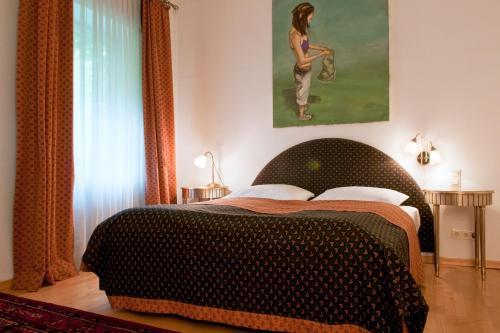 מיטה או מיטות בחדר ב-Hotel Kunsthof