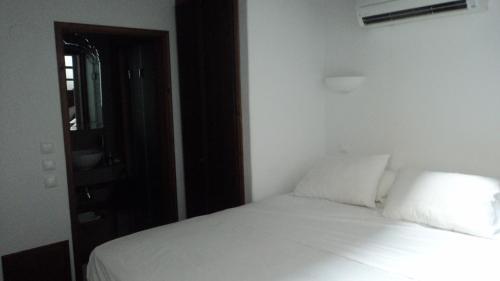 Un ou plusieurs lits dans un hébergement de l'établissement Domus Studios