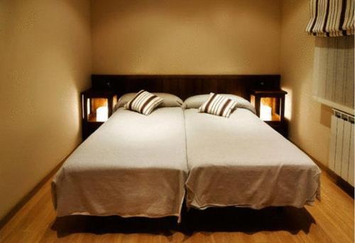 A bed or beds in a room at Hostau Era Claverola