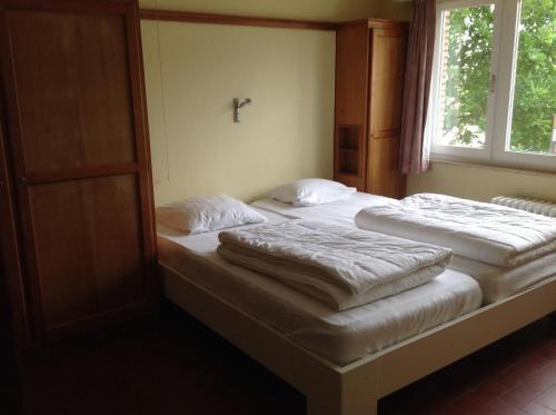 Een bed of bedden in een kamer bij Villa Maran