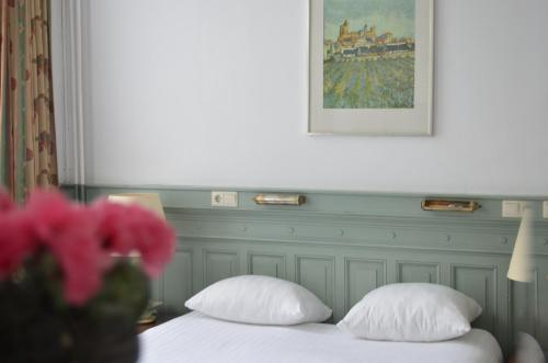 A bed or beds in a room at Hotel de Munck