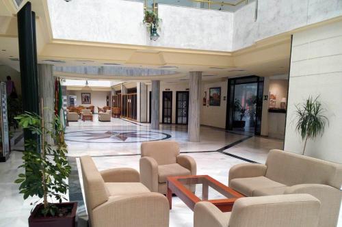 The lobby or reception area at Hotel San Pablo Sevilla