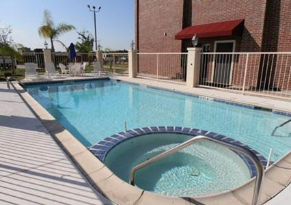 The swimming pool at or near Americas Best Value Inn & Suites Port Arthur