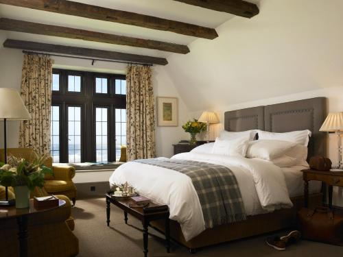 A bed or beds in a room at Trump International Golf Links & Hotel Doonbeg Ireland