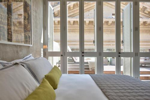 A bed or beds in a room at Casa Ellul - Small Luxury Hotels of the World