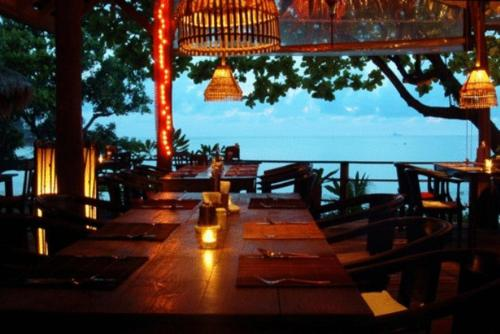 A restaurant or other place to eat at Relax Bay Resort