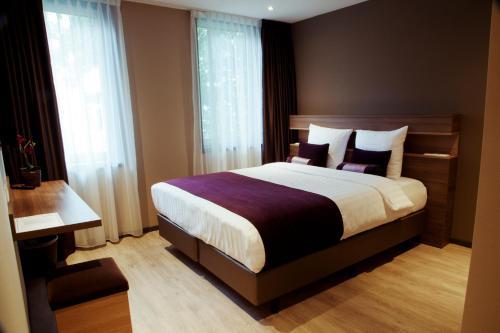 Кровать или кровати в номере Dream Hotel Amsterdam