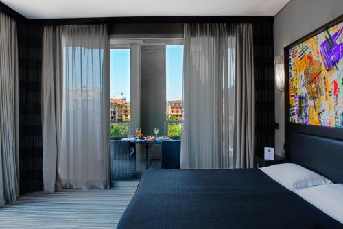 Cama o camas de una habitación en Twentyone Hotel