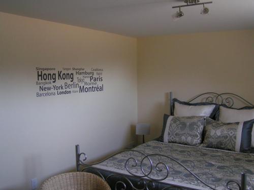 A bed or beds in a room at Nowak's Own B&B