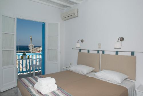 Ein Bett oder Betten in einem Zimmer der Unterkunft Asimina