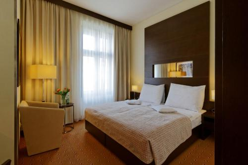 A bed or beds in a room at Clarion Hotel Prague City