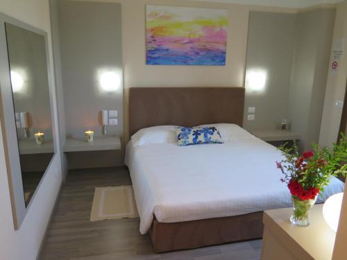 Letto o letti in una camera di Hotel Motel Piu'